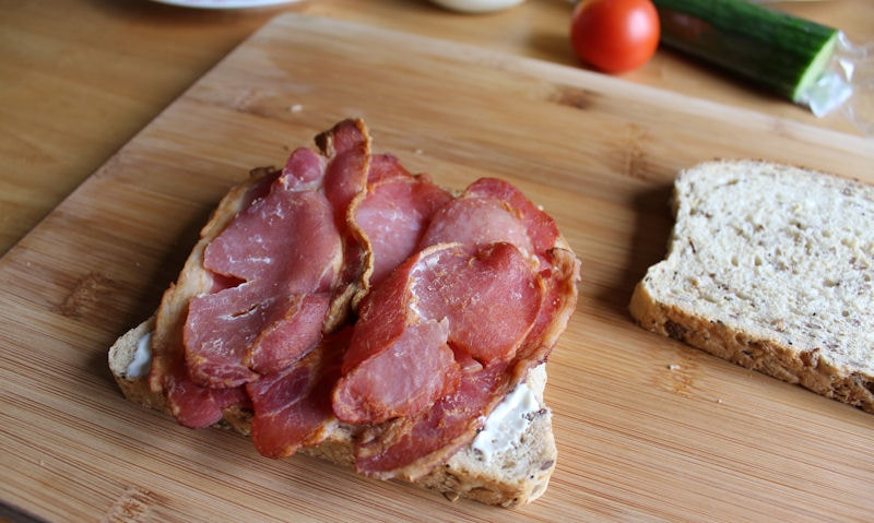 Slices of bacon layered on mayonnaise sliced bread