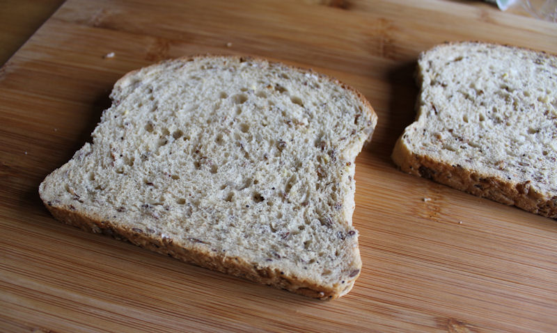 Two slices of wholemeal bread on chopping board