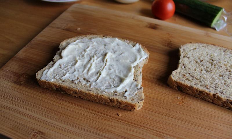 Mayonnaise spread on bottom wholemeal bread slice