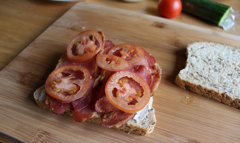 Tomatoes piled on top of bacon