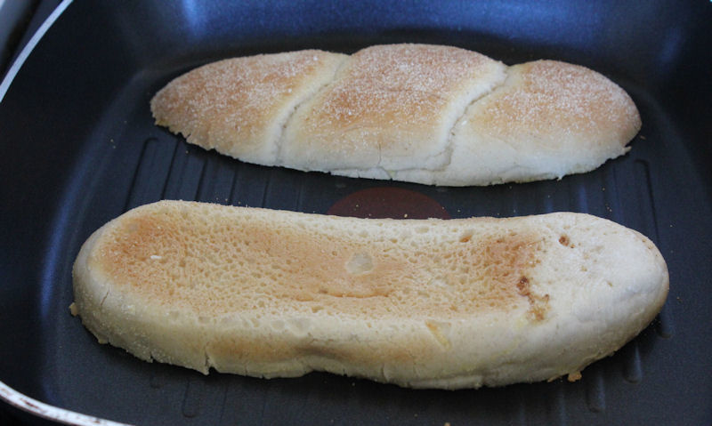 Toasting sub rolls face down in pan