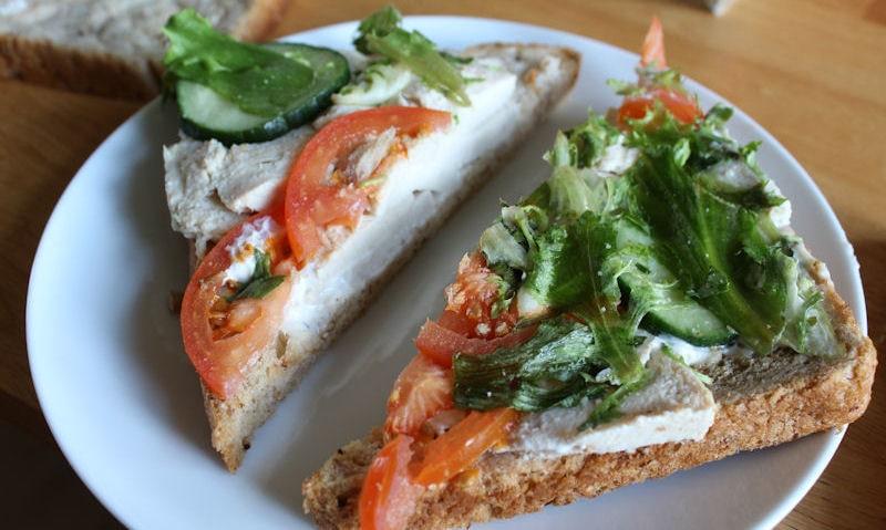 Opened chicken salad sandwich