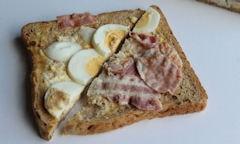 Tesco Egg & Bacon Sandwich, halves on display