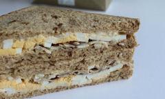 Tesco Egg & Bacon Sandwich, bacon seen out of sandwich