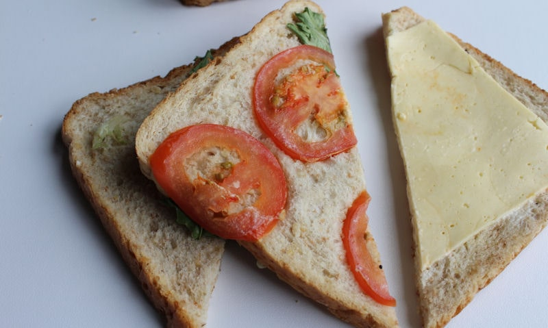One half contains cheese, tomato and mayo