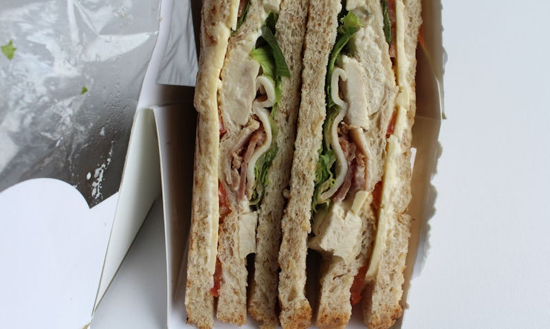 Club sandwiches still in packet, ripped open