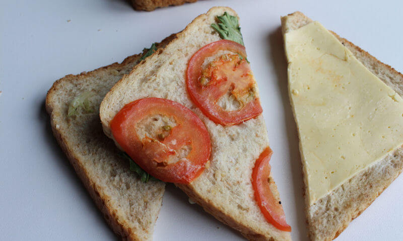 The Chicken Club Sandwich, tomato slices on bread
